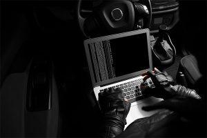 a thief hacking a car
